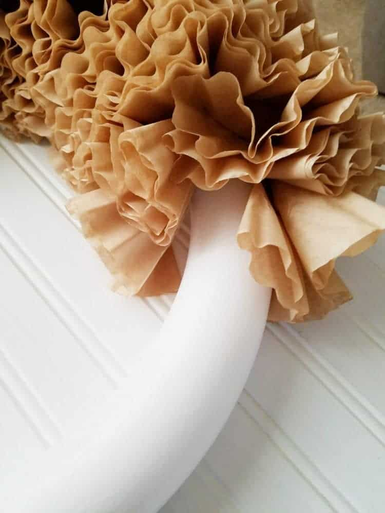 Attach folded filters to styrofoam wreath staggering across the wreath using floral pins.