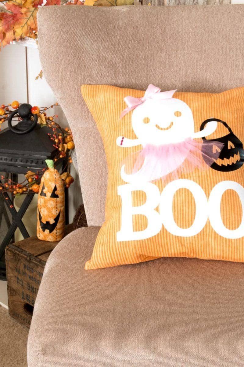 Decorating for Halloween can be cute or frightful but this little Boo Pillow fits perfectly into the Cute Halloween Decor category. Using a simple DIY envelope pillow as the base, adding an iron-on Ghost and Boo from the Cricut Design Space and a few extras your little ghost pillow goes from plain to adorable Boo-lerina in just 15 minutes.