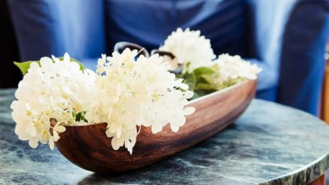 Farmhouse style hydrangea display in wooden bowl with vintage garden clippers
