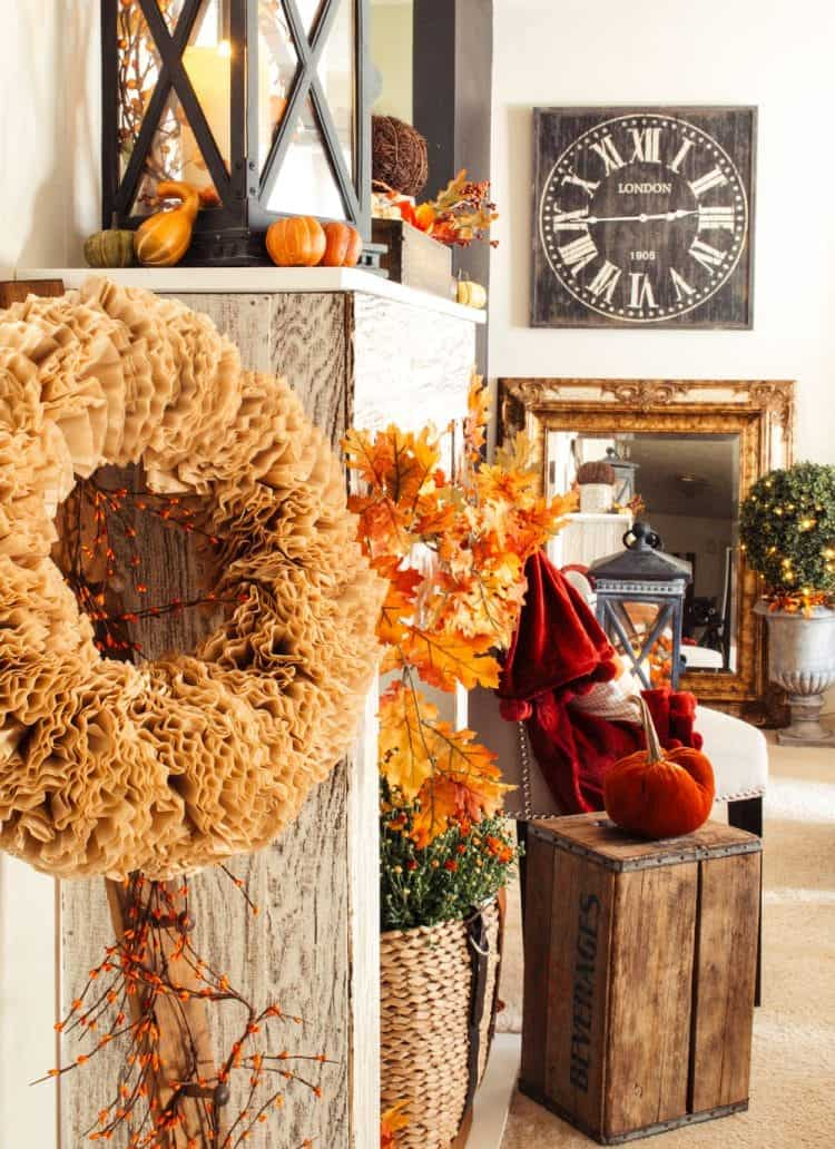 Huge wreath made with coffee filters, gourds, velvet pumpkins, mums and other fall decor