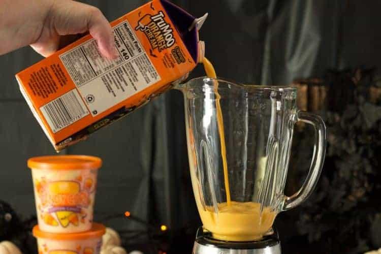 TruMoo Orange Scream being added to a blender for making a Halloween FreakShake Milk Shake