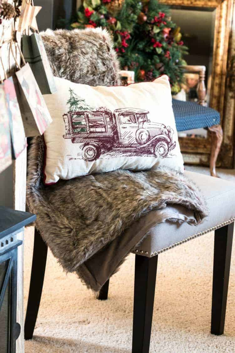 How To Style a Fun Christmas Lodge Style Mantel - faux fur throw on Chair for Christmas from At Home