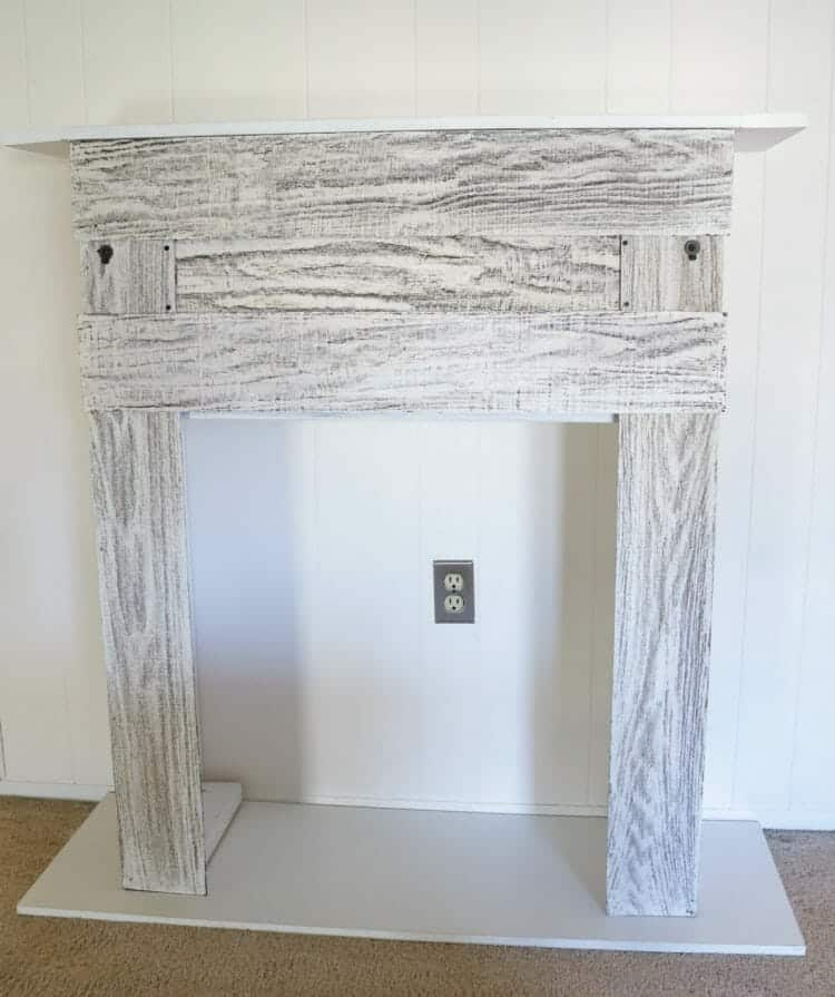 DIY Faux Fireplace made from an old kitchen cabinet