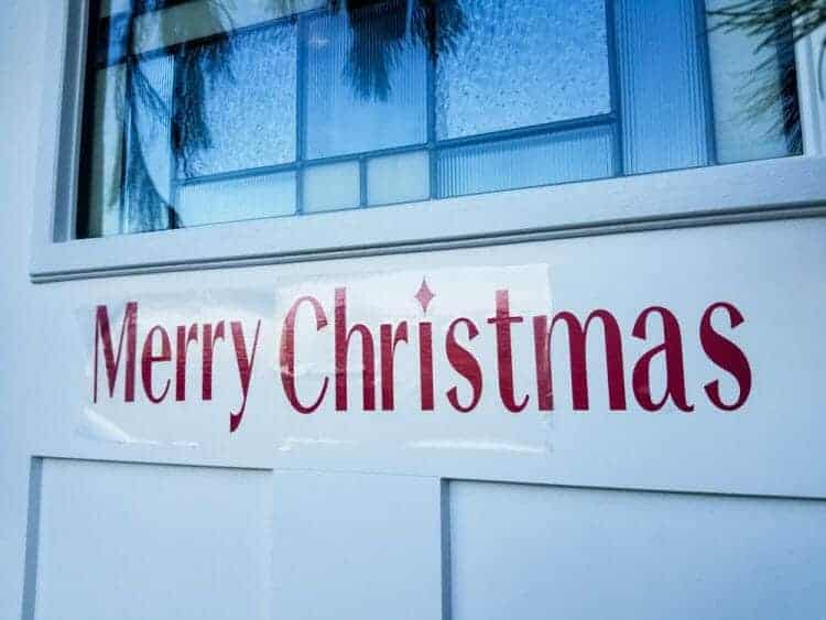 Merry Christmas Holiday Greeting on Front Door made with Cricut