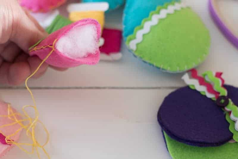 Fiber Fill stuffing inserted into bright pink felt Easter Egg