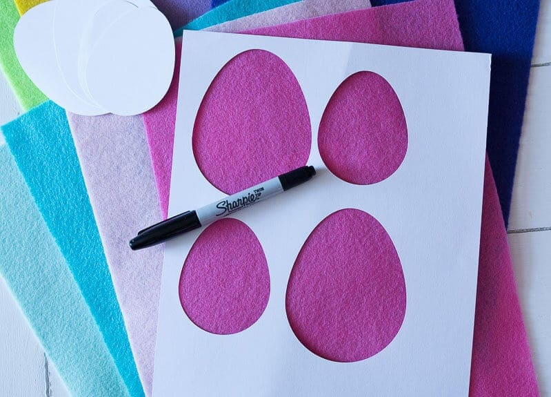 Card stock template for tracing an Easter Egg pattern on to felt with a black Sharpie pen