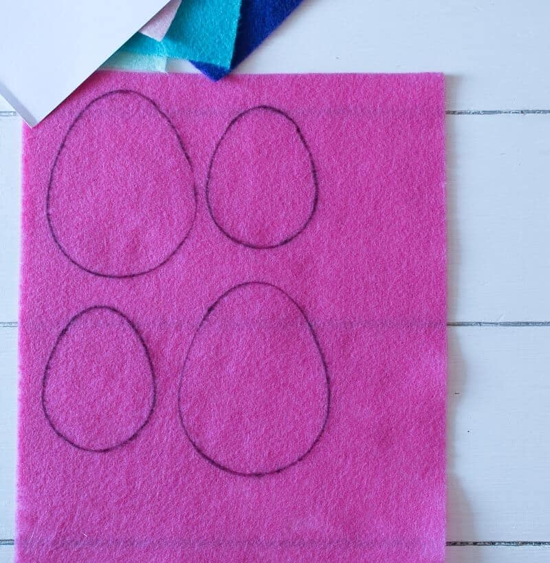 Piece of pink felt with egg shapes traced using a Sharpie