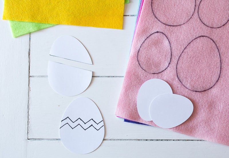 Four pieces of felt with small and large egg shapes traced on to them