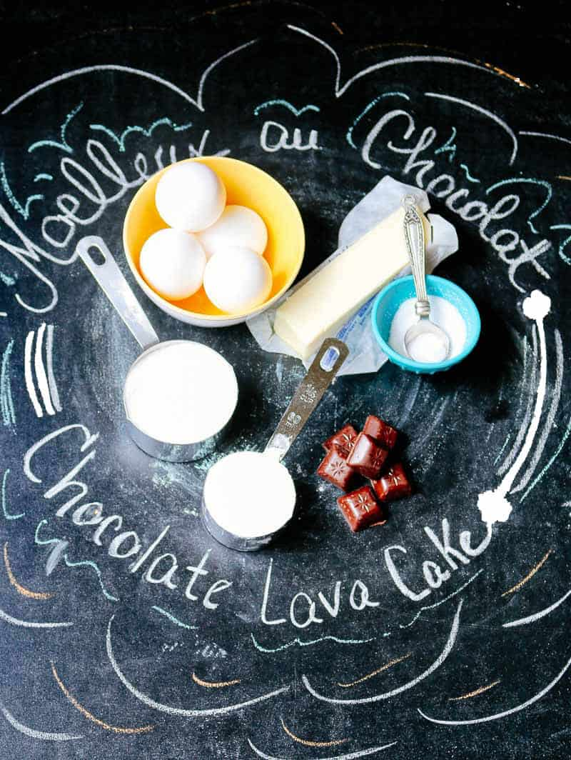 Ingredients for chocolate molten lava cake on chalkboard background