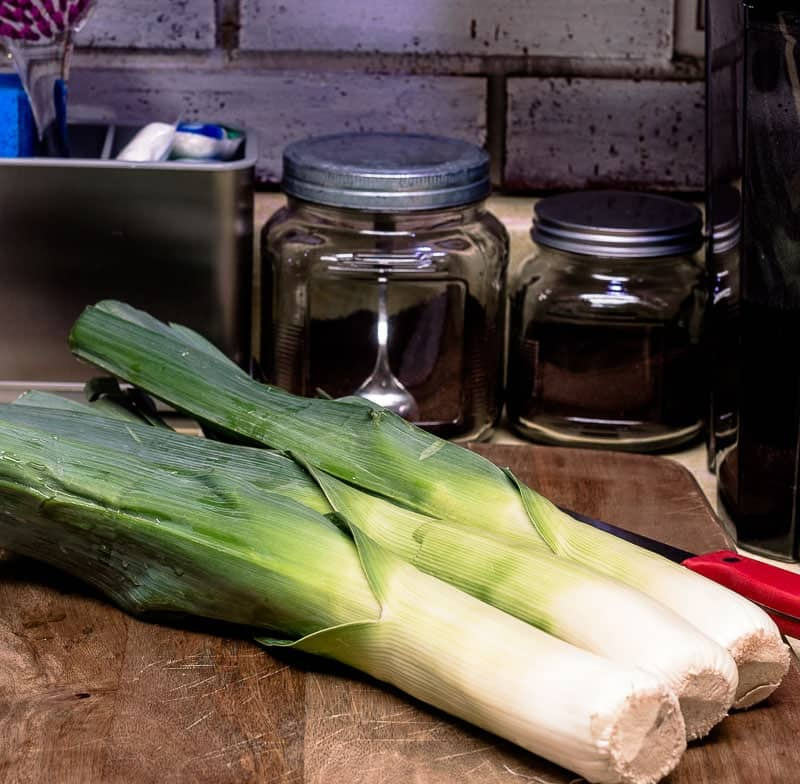 Three leeks on cutting board