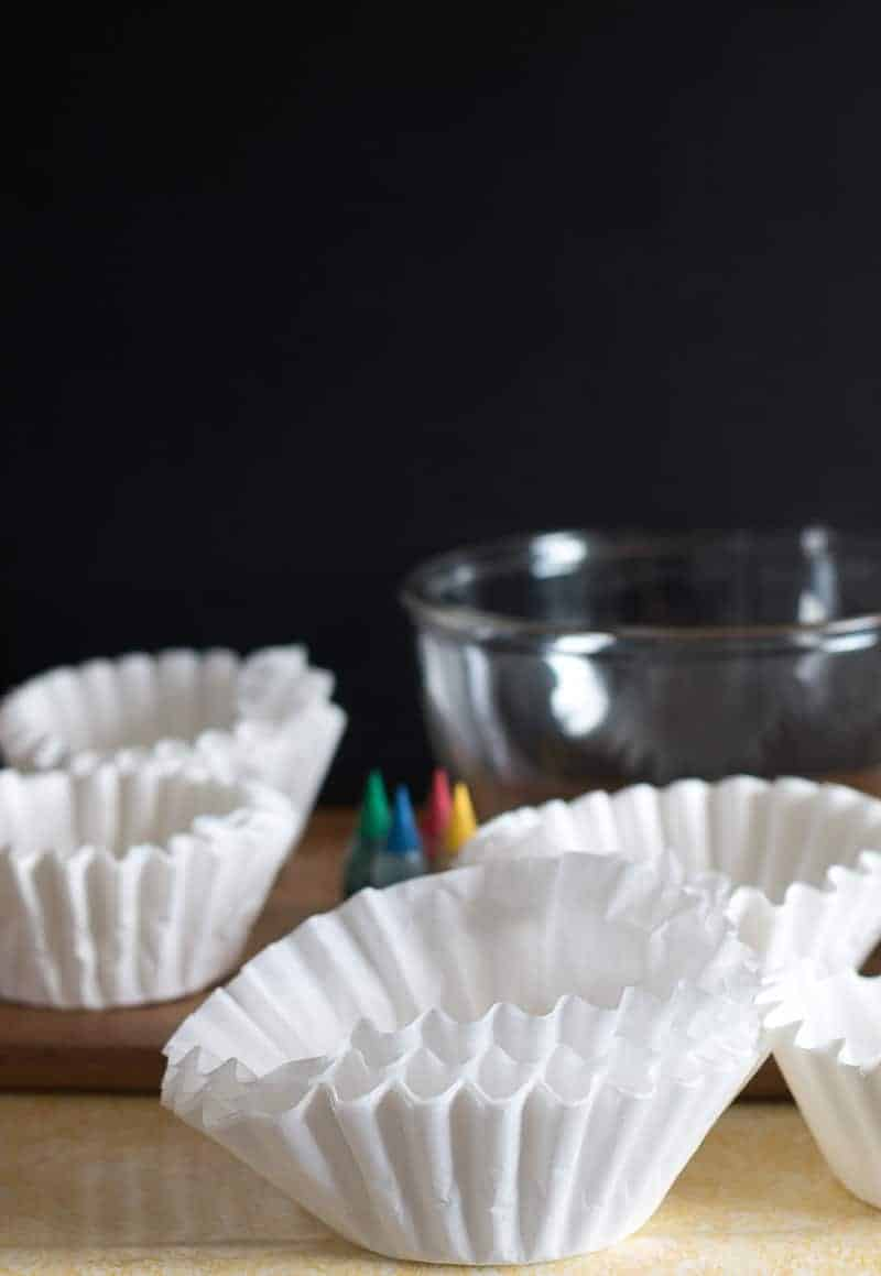 Supplies for dying coffee filters with food coloring - coffee filters, food coloring, and glass bowl