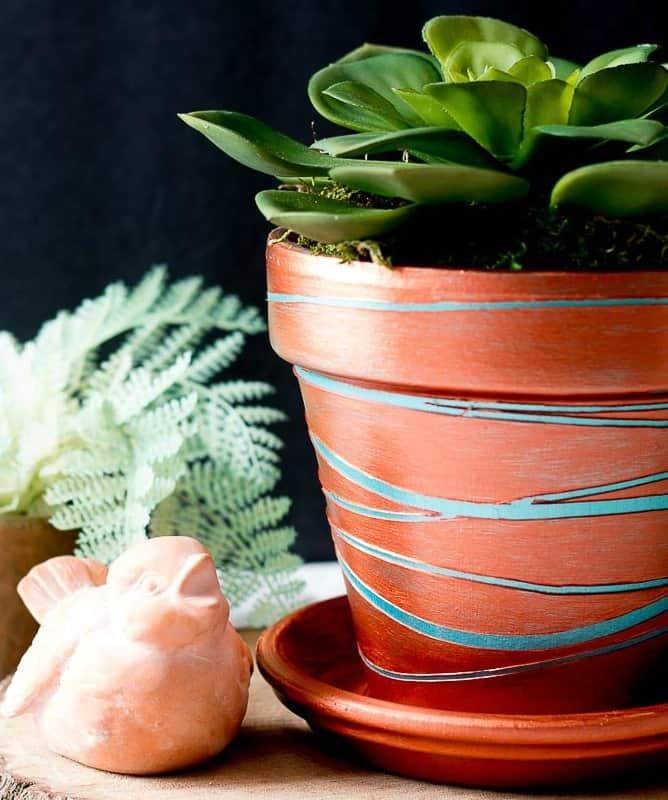 Metallic copper planter with a succulent