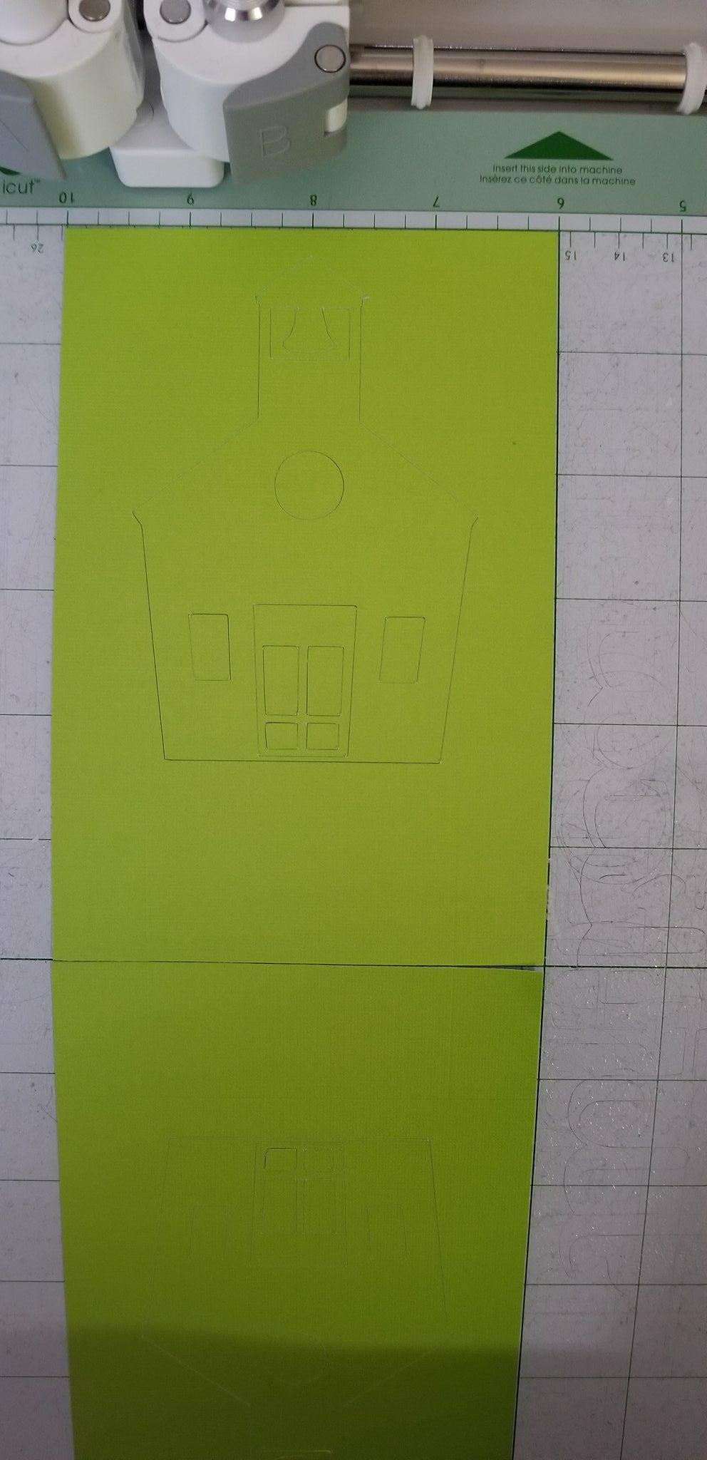 Close up of green schoolhouse cut using Cricut machine for teacher appreciation gift ideas