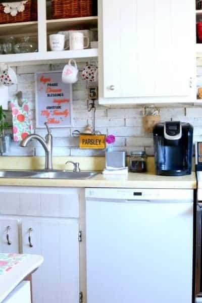 Photo of white kitchen cabinets and older kitchen