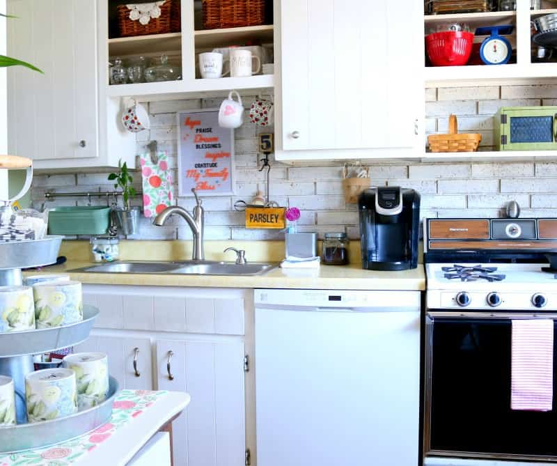 Photo of white kitchen cabinets and older kitchen