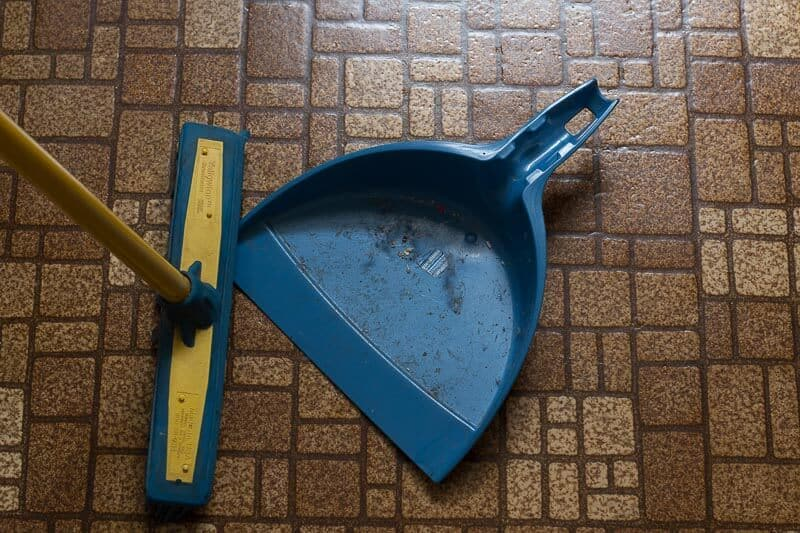 broom and dustpan on floor