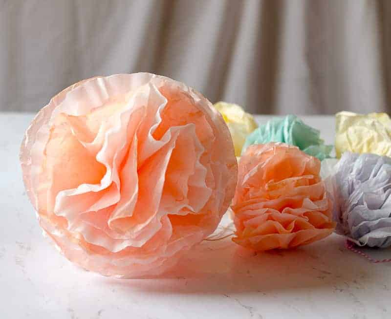Coral colored coffee filter pom pom garland flower