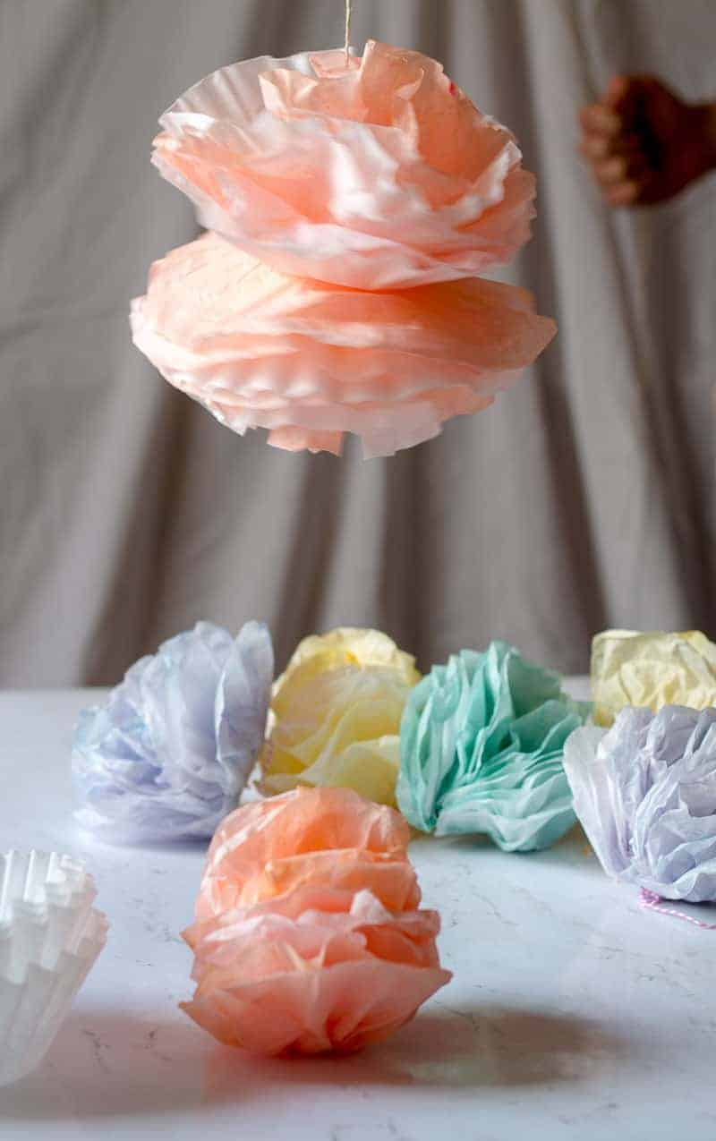 Coffee filter pom pom garland flower swinging in the air