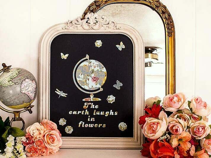 Close up of Vintage Mirror and Shabby Chic Chalkboard with Floral Globe