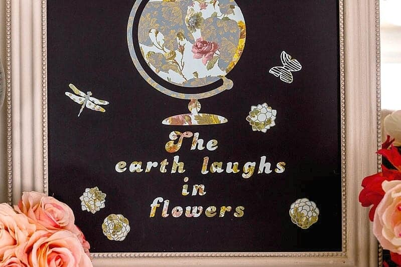 close up of Shabby Chic Chalkboard with vintage appearing floral globe and Ralph Waldo Emerson Quote perfect for spring and year round decorating