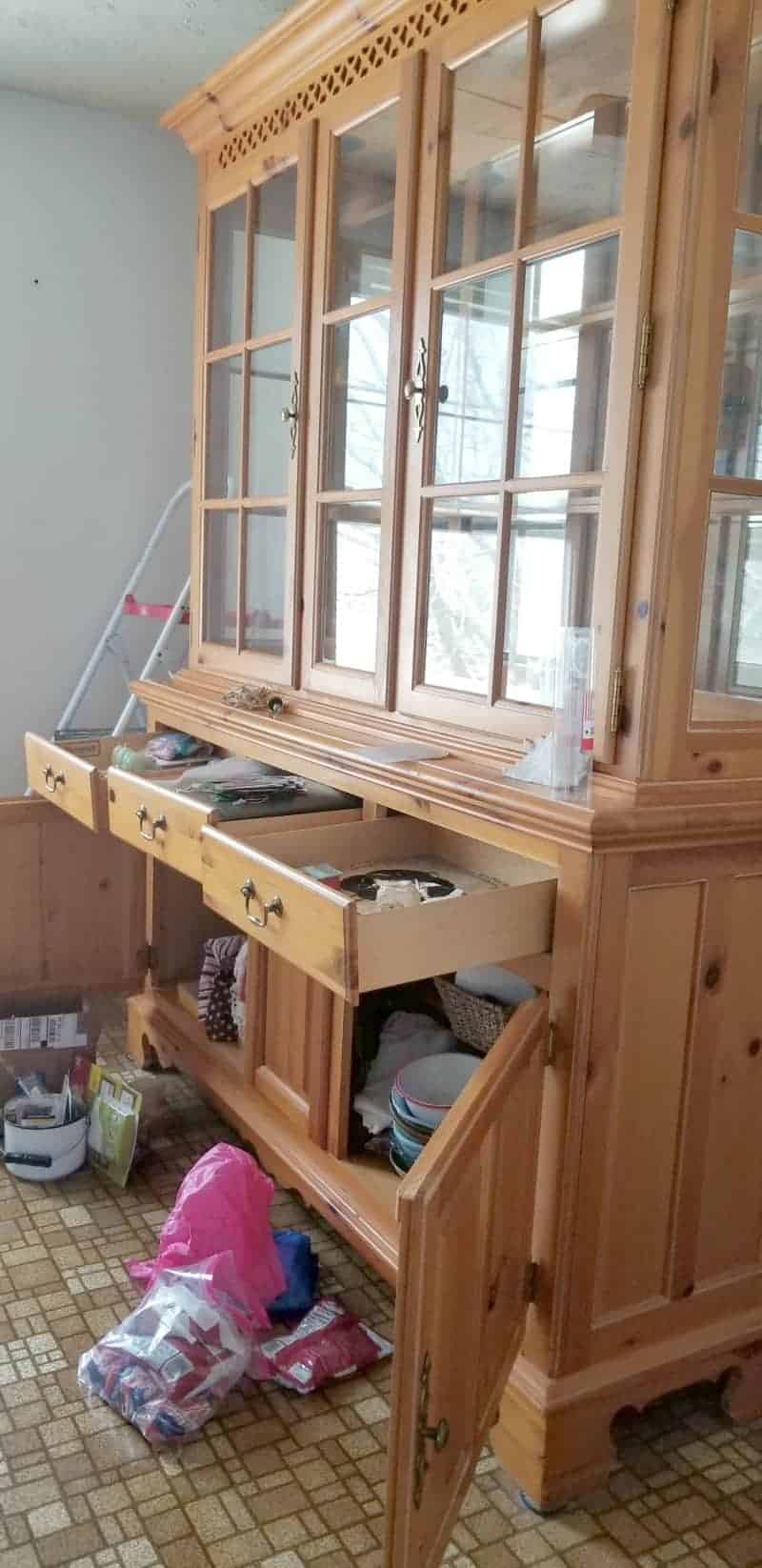 China cabinet with drawers open and items out - the one word that changed my life