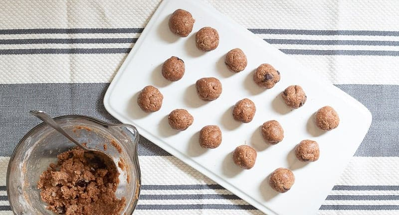 Chocolate Chip Cookie Dough Protein Bites rolled in balls on white platter