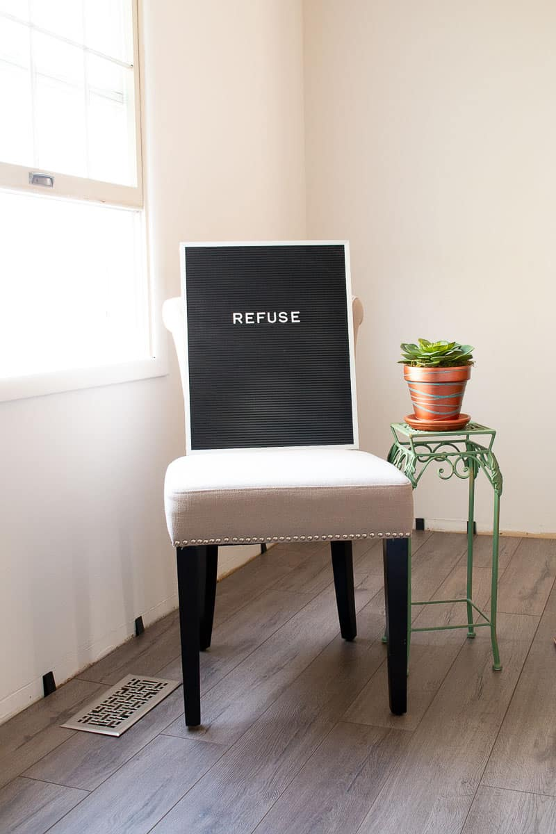 Formal dining room chair with letterboard on it - The One Word That Changed My Life