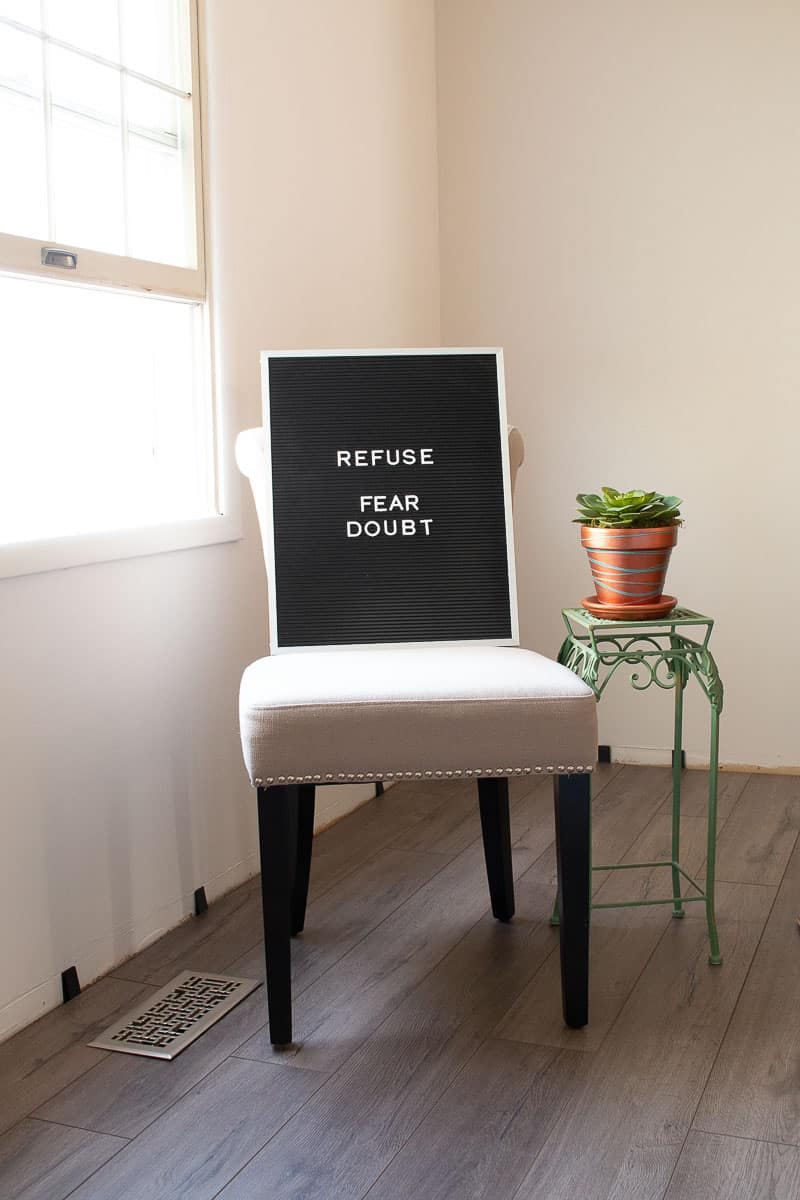 Letterboard with Words Refuse Fear and Doubt - the one word that changed my life