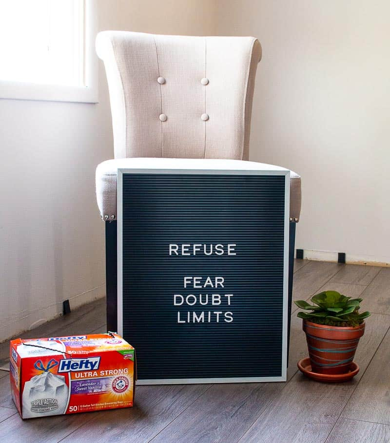 Farmhouse plank flooring kitchen makeover with letterboard and words Refuse Fear Doubt Limits, Box of Hefty Trash Bags and copper terra cotta plant pot with faux succulent - the one word that changed my life