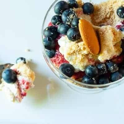 overhead view of No Bake NILLA Cheesecakes withe Fresh Fruit and bite on small silver spoon