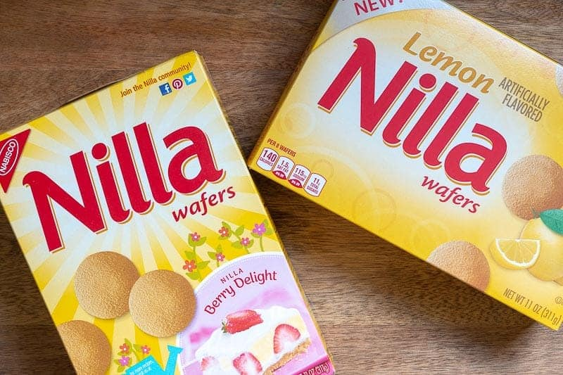 Overhead view of one box of traditional NILLA wafers and one box of Lemon NILLA Wafers on cutting board