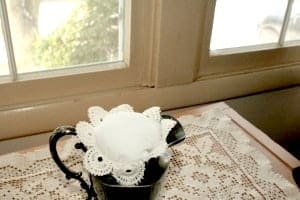 vintage creamer with vintage lace doily stuffing