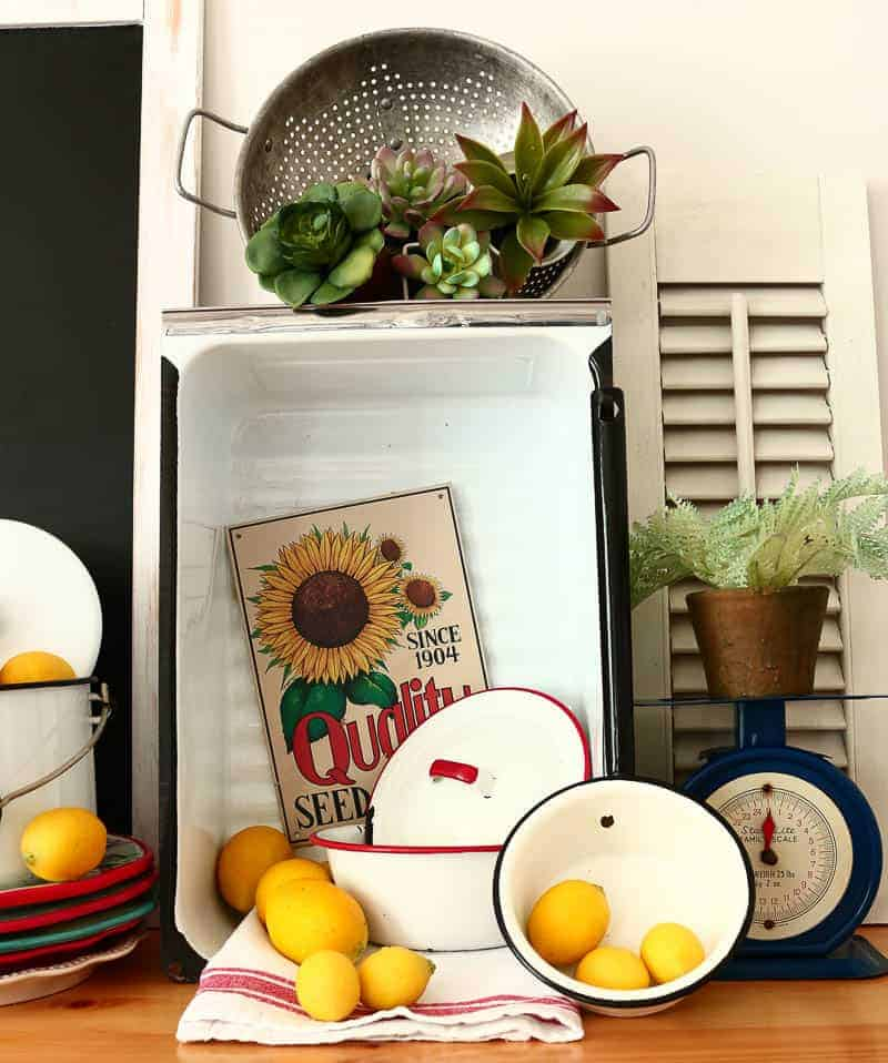 Enamelware bowls with lids and an enamelware refrigerator drawer - enamelware decorating ideas