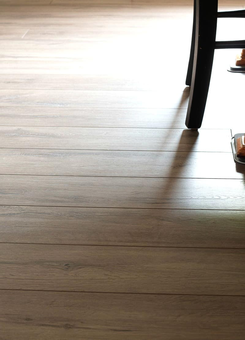 Floor view of Farmhouse Plank Flooring with black wooden chair on top of floor