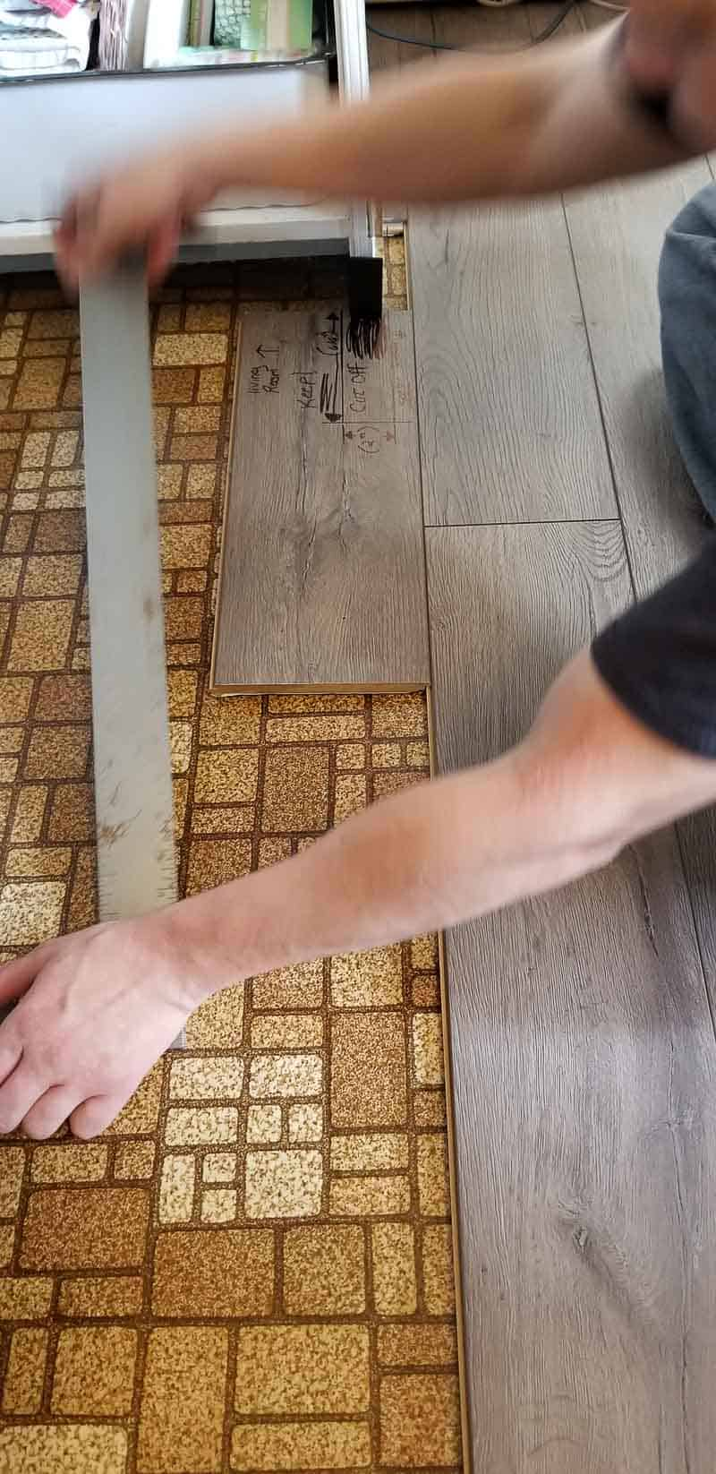 Large carpenter square on floor for measuring cuts