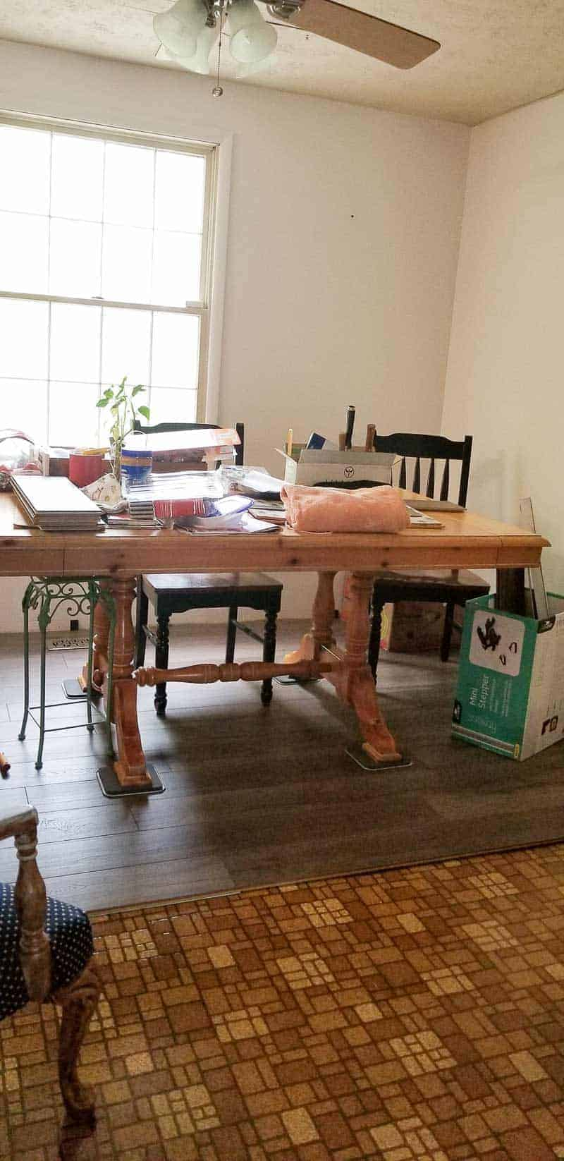 Dining room table on Farmhouse Plank Flooring with old brown 1970's laminate still showing