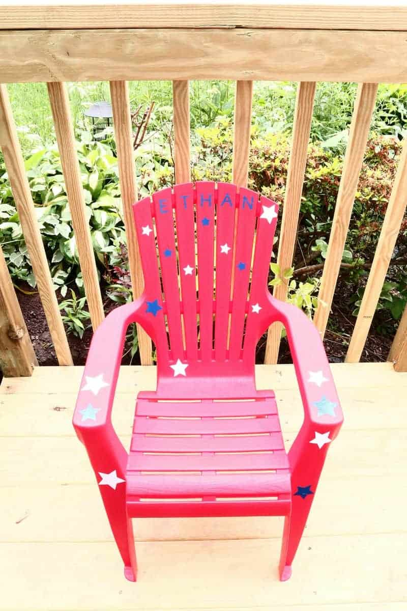 Red Adirondack Child's Chair from Target embellished with vinyl stars using Cricut Design Space