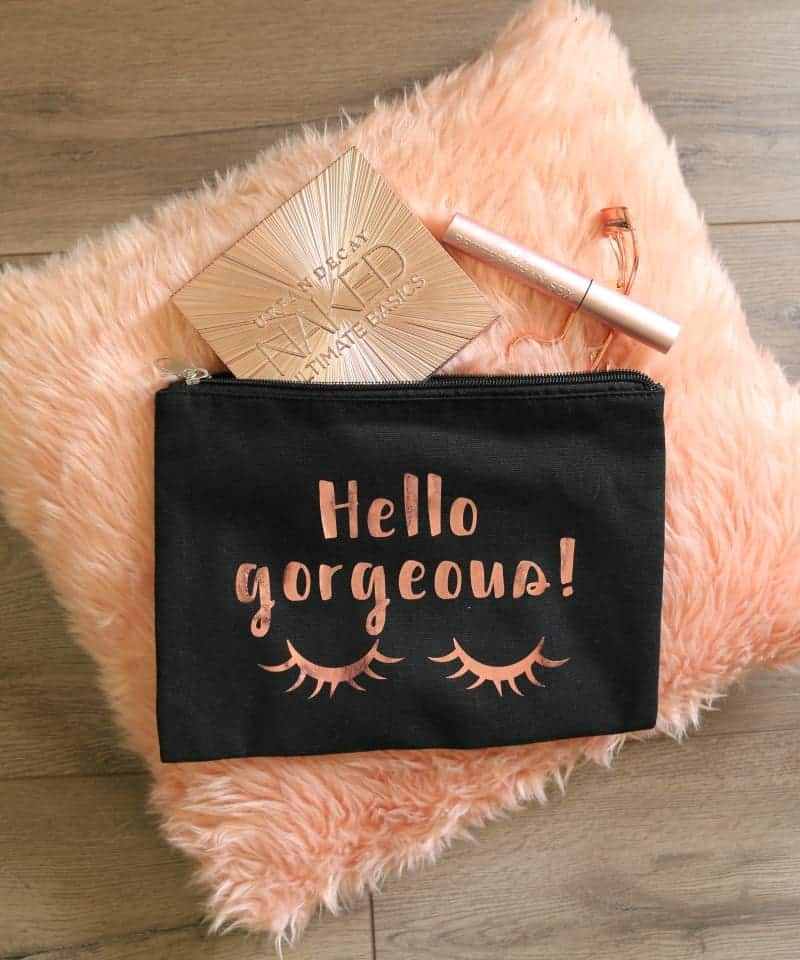 Rose Gold Hello Gorgeous Makeup Bag on Rose Gold Pillow
