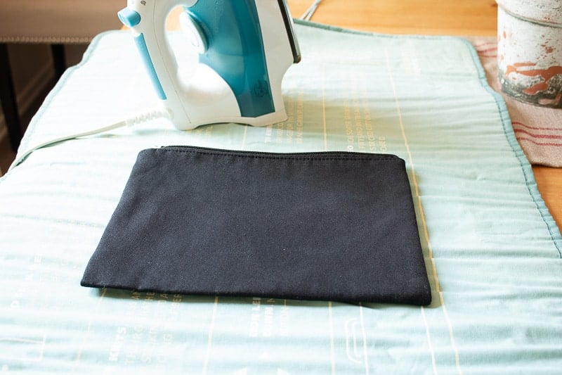 Black canvas makeup bag ironed to heat up before ironing on vinyl