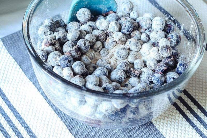 Fresh blueberries tossed with flour, sugar, and cinnamon for blueberry pie filling