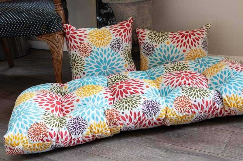 Colorful outdoor cushions from At Home on farmhouse plank flooring