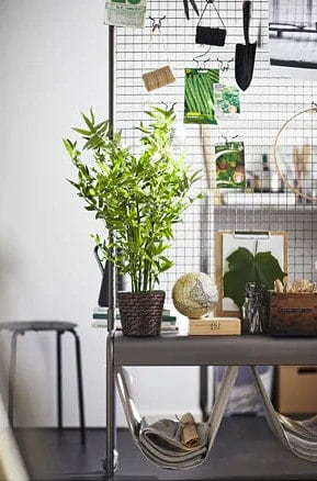 room divider with mesh screen to hang items including plants, purses, craft supplies, office supplies, and more from Ikea