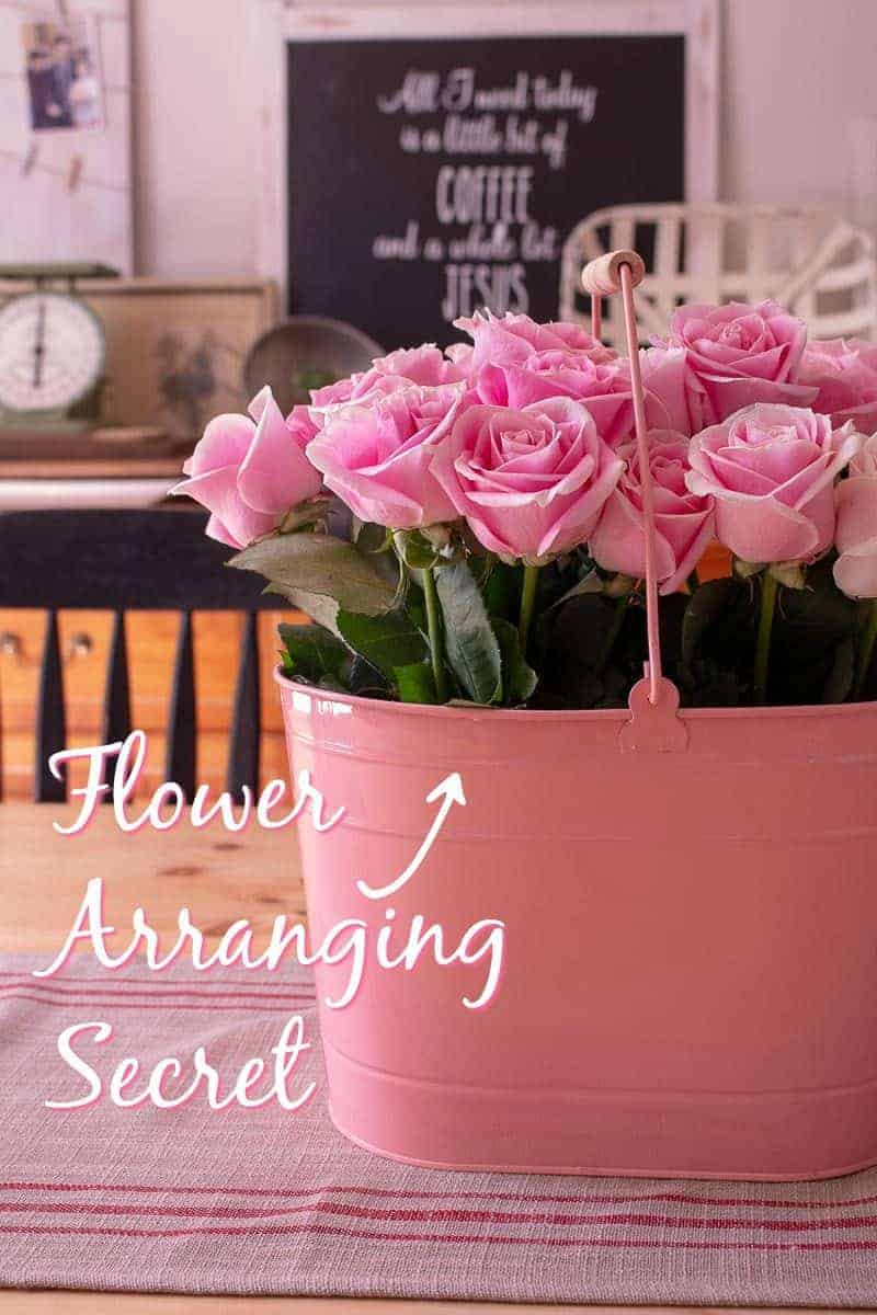 How to arrange flowers - Pink metal bucket filled with open blooming pink roses