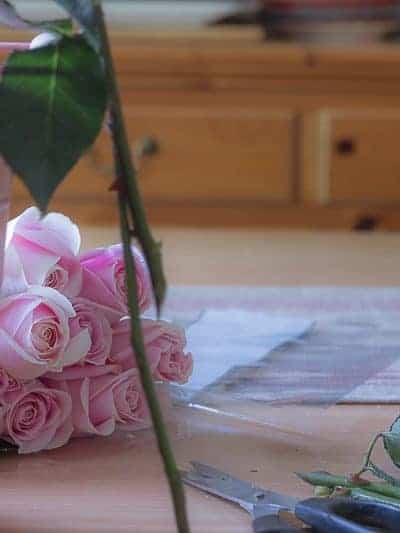 Pink bucket and two dozen pink roses