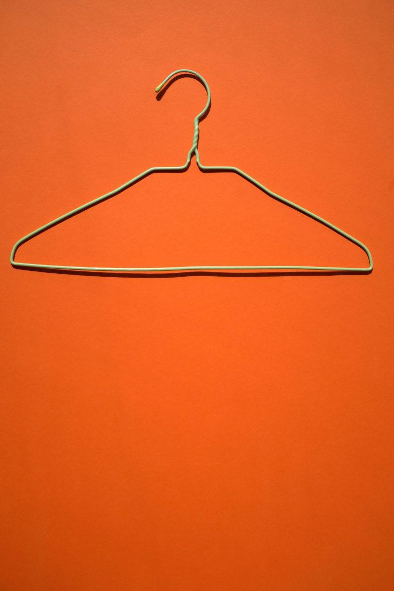 Wire hanger on orange background