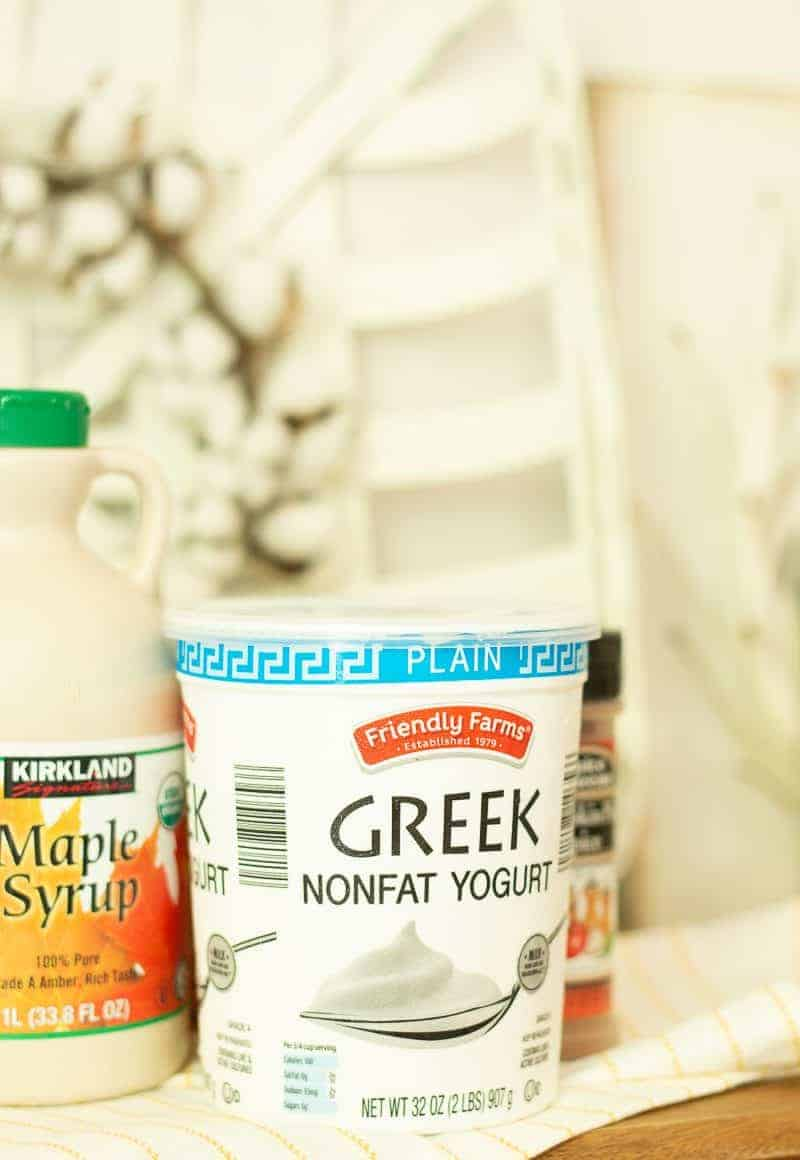 Container of fat-free Greek yogurt used in healthy pumpkin pie smoothie recipe