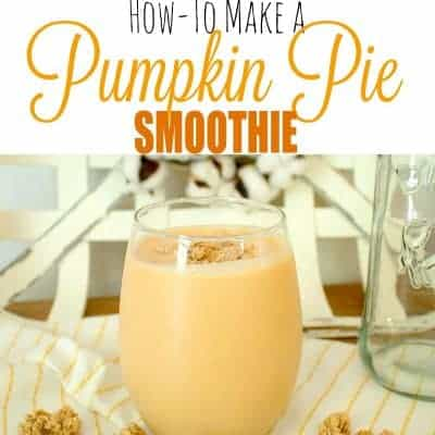 Healthy Pumpkin Pie Smoothie in Glass on yellow striped towel with granola