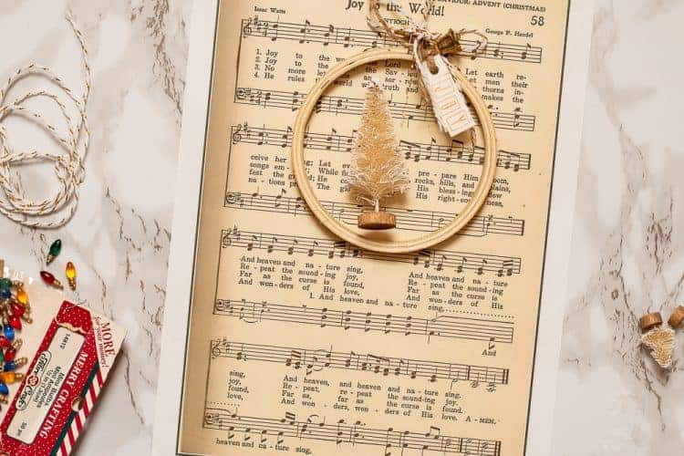 overhead view of Joy to the World Vintage Music Sheet used to make an embroidery hoop Christmas Ornament