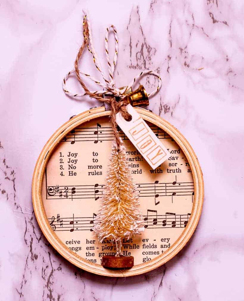 Overhead view of music sheet embroidery hoop Christmas ornament