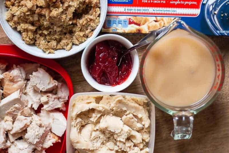 Overhead view of Thanksgiving Leftovers, turkey, stuffing, mashed potatoes, gravy, and cranberry sauce